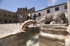 Middle-aged man cooling in the fountain gate of Jaen Baeza Royalty Free Stock Photos