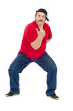 Middle aged man dances rap. Middle aged man in red shirt dances rap on a white background Stock Photo