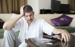 Middle aged man in debt royalty free stock images