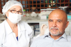 Middle aged man with dentist Royalty Free Stock Image