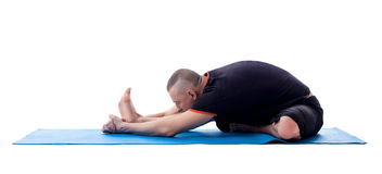 Middle aged man doing workout on gymnastic mat Royalty Free Stock Photos