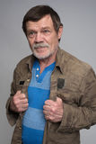 Middle-aged man dressed in a gray jacket. Isolated on Stock Photography