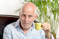 A middle-aged man drinking coffee Stock Images