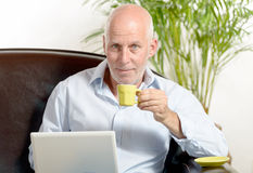 A middle-aged man drinking coffee Royalty Free Stock Photos