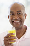 Middle Aged Man Drinking Fresh Orange Juice Royalty Free Stock Image
