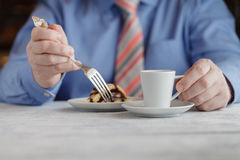 Middle Aged Man Eating Cheesecake Stock Photography