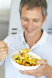 Middle Aged Man Eating Fresh Fruit Salad Royalty Free Stock Photos