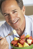Middle Aged Man Eating Fresh Fruit Salad Royalty Free Stock Photography