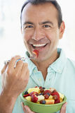 Middle Aged Man Eating Fresh Fruit Salad Royalty Free Stock Image
