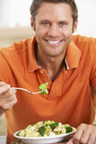Middle Aged Man Eating A Healthy Meal Royalty Free Stock Photography