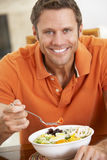 Middle Aged Man Eating A Healthy Meal Royalty Free Stock Images