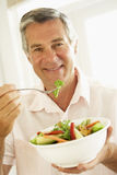 Middle Aged Man Eating A Healthy Salad Stock Photography