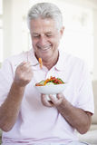 Middle Aged Man Eating Salad Stock Photo