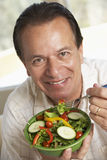 Middle Aged Man Eating Salad royalty free stock photo