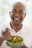 Middle Aged Man Eating Salad royalty free stock images