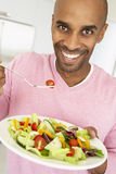 Middle Aged Man Eating A Salad royalty free stock photos