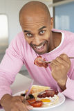 Middle Aged Man Eating Unhealthy Fried Breakfast Royalty Free Stock Images