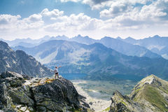 Middle aged man enjoying adventure in the mountains Royalty Free Stock Images