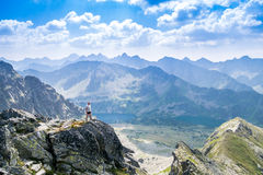 Middle aged man enjoying adventure in the mountains Stock Images