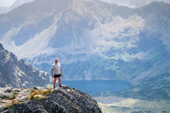 Middle aged man enjoying adventure in the mountains Royalty Free Stock Photo