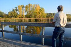 Middle-Aged Man Enjoying the Fall Colors royalty free stock photos
