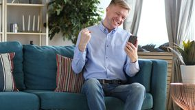 Middle Aged Man Excited for Success while Using Smartphone stock video footage