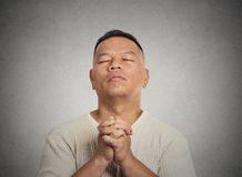 Middle aged man eyes closed praying looking up Stock Photos