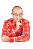 Middle aged man with finger on his mouth Royalty Free Stock Image