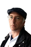 Middle aged man in flat cap. With coat and glasses, white background Stock Images
