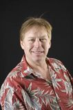 Middle aged man in floral shirt man Royalty Free Stock Photography