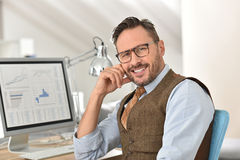 Middle-aged man in front of desktop computer Royalty Free Stock Image