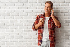 Middle aged man with gadget Royalty Free Stock Photos
