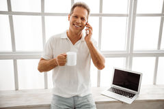Middle aged man with gadget stock photo