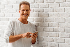 Middle aged man with gadget Royalty Free Stock Image