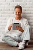 Middle aged man with gadget Royalty Free Stock Photo