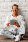 Middle aged man with gadget Stock Image