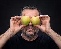 Middle-aged man with a green apples Stock Photo