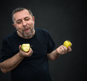 Middle-aged man with a green apples Stock Image