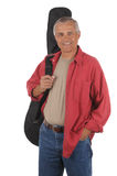 Middle aged Man with Guitar Case Over Shoulder Royalty Free Stock Photo