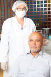 Middle aged man happt with dentist Royalty Free Stock Photography