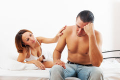 Middle-aged man has problem,  wife comforting him Stock Photo
