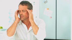 Middle aged man having an headache stock footage