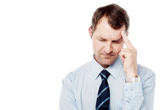 Middle aged man having headache Stock Image
