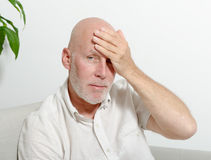 Middle-aged man with headache Stock Image