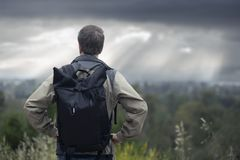 Free Middle-Aged Man Hiking Alone In Mountains With Cloudy Skies Royalty Free Stock Images - 160617479