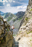 Middle aged man hiking and climbing mountains. Royalty Free Stock Photo