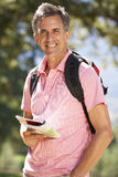 Middle Aged Man Hiking Through Countryside Stock Photography