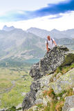 Middle aged man hiking in the mountains Stock Image