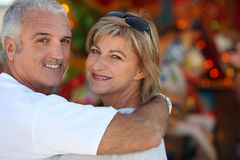 Middle aged man with his arm around his wife Royalty Free Stock Photos