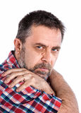 Middle-aged man with his arms crossed on his shoulders Royalty Free Stock Photo